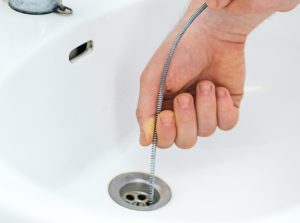 A sink or hand-held auger